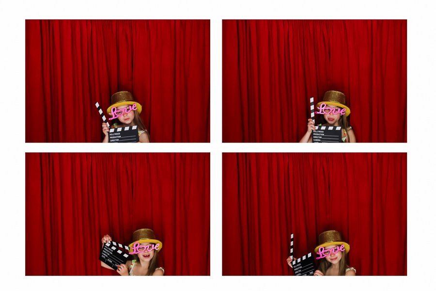 Child posing in the wedding photo booth