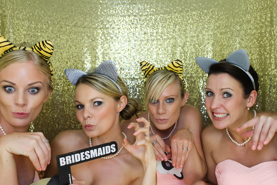 bridesmaids in the gold photo booth
